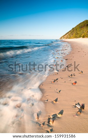 Baltic Sea shore a few minutes before sunset. - stock photo
