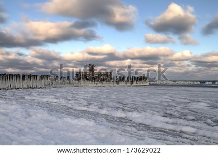 Baltic sea shore in snowy winter at the sunset, Gdynia Poland  - stock photo