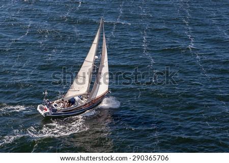 Baltic Sea/Sweden - Jul 31, 2014: Yacht cruising through waters of Baltic sea - stock photo