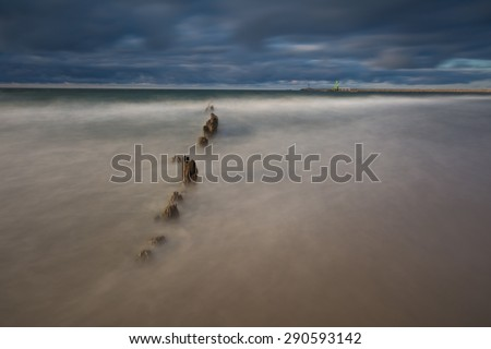 Baltic shore. Beautiful dramatic weather seascape of polish shore of Baltic sea and mouth of Vistula river in Gdansk.