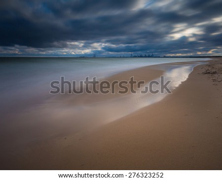 Baltic shore photographed on long exposure. Dark dramatic seascape of polish shore of Baltic sea. - stock photo