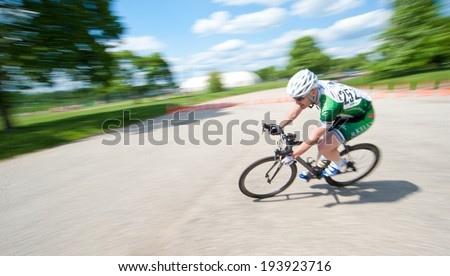 BALTIMORE, MARYLAND - MAY 18: A cyclist competes in the elite men's competition at BikeJam on May 18, 2014 in Baltimore, Maryland