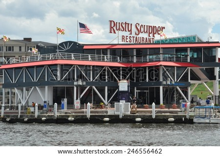 BALTIMORE, MARYLAND - SEP 1: Rusty Scupper Restaurant & Bar at the Inner Harbor in Baltimore, Maryland, as seen on Sep 1, 2014. It is a local landmark serving upscale regional seafood dishes. - stock photo