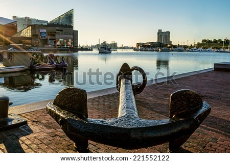 BALTIMORE, MARYLAND-SEPTEMBER 27-A large old anchor along the waterfront of the Inner Harbor on September 27 2014 in Baltimore Maryland. The Inner Harbor is a popular tourist destination. - stock photo