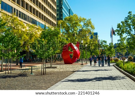 BALTIMORE, MARYLAND-SEPTEMBER 27-A view of office buildings and street sculpture near the Inner Harbor on September 27 2014 in Baltimore Maryland. - stock photo