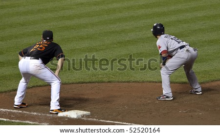 BALTIMORE - MAY 1: Dustin Pedroia of the Boston Red Sox stands at first base during a game at Camden Yards on May 1, 2010 in Baltimore, Maryland