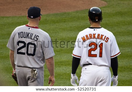 BALTIMORE - MAY 1: Nick Markakis of the Baltimore Orioles stands at first base during a game at Camden Yards on May 1, 2010 in Baltimore, Maryland - stock photo