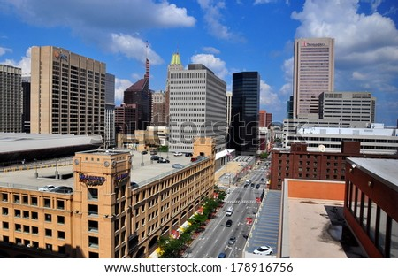 Baltimore, MD - July 24, 2013:  View of corporate office towers, hotels, and modern buildings lining busy Pratt Street  - stock photo