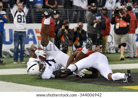BALTIMORE - OCTOBER 24: Penn State Nittany Lions wide receiver Geno Lewis (7) grabs a leaping touchdown reception during the NCAA football game against Penn State October 24, 2015 in Baltimore.  - stock photo