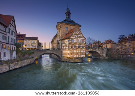 Bamberg. The Old Town Hall (1386) of Bamberg was built in the middle of Regnitz river. Two bridges connect it with the Old Town of Bamberg which is listed as a UNESCO World Heritage. - stock photo