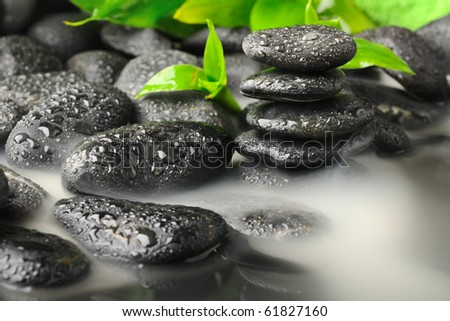 bamboo and black stones in the smoke - stock photo