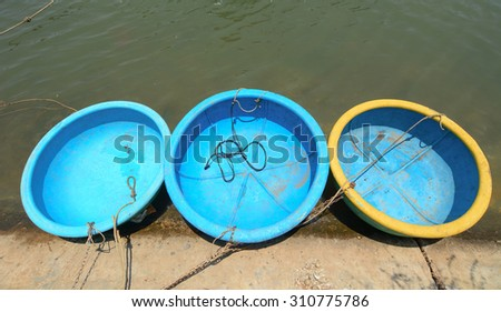 Bamboo basket boats on beautiful beach in Phan Thiet, Vietnam. - stock photo
