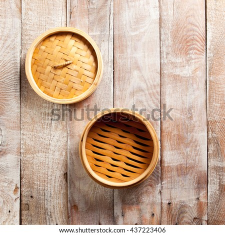 Bamboo Basket Steamer on Wood Background - stock photo