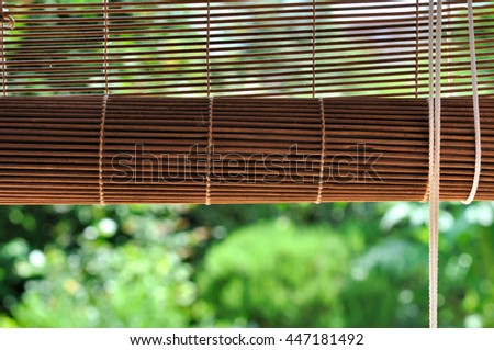 bamboo blind at a window overlooking garden