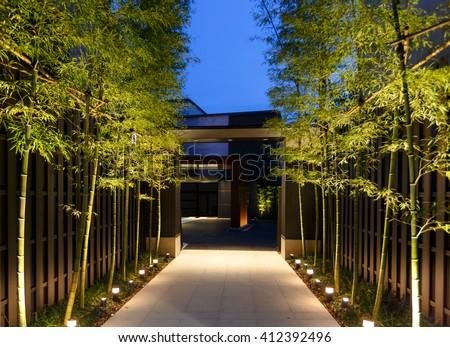 bamboo decoration beside walk path - stock photo