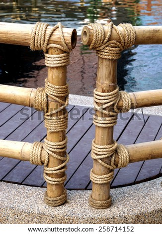 Bamboo fence was built as a rope tied to a bamboo fence. - stock photo
