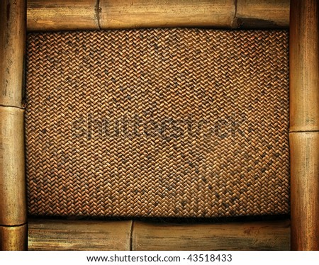 bamboo frame on rattan background - stock photo