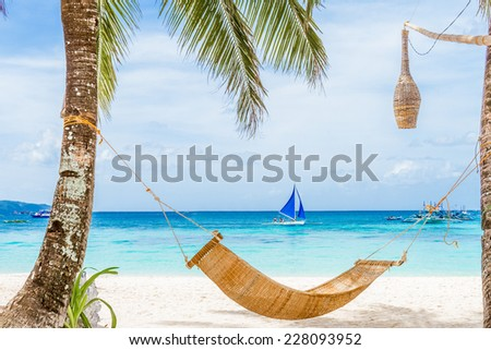bamboo hammok on tropical beach and sea background, summer vacations - stock photo