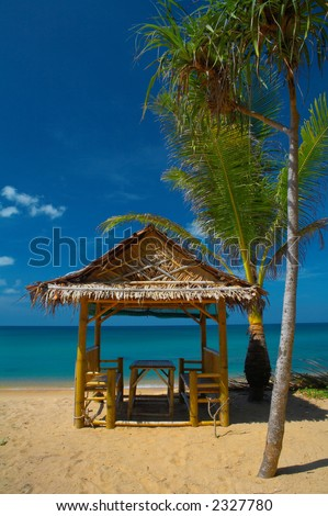 bamboo house on the sandy beach - stock photo