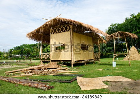 Bamboo hut(under-construction) in the forest - stock photo