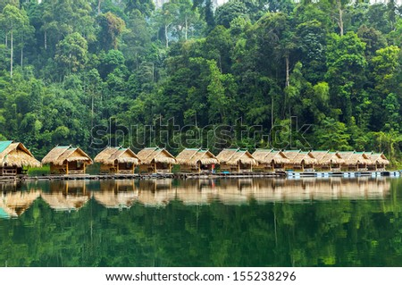 Bamboo huts on the lake Cheo Lan in Thailand. - stock photo