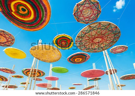 Bamboo many colorful, handmade on sky in Thailand - stock photo