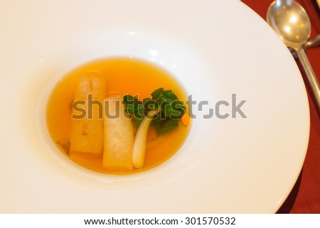 Bamboo mushroom soup in modern porcelain bowl - stock photo