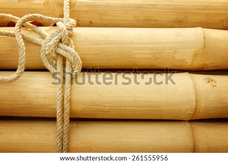 Bamboo panel with a rope tied. - stock photo