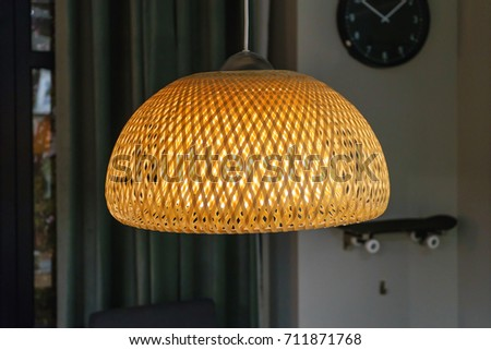 Bamboo pendant light lamp hanging above stock photo royalty free bamboo pendant light lamp hanging above white walls and wall clock aloadofball Choice Image