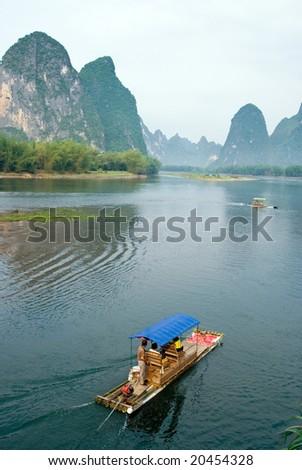 Bamboo raft on the Li river near Yangshuo, Guanxi province, China - stock photo