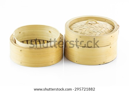 Bamboo round container shape for steaming asian food, Bamboo steamer isolated on white background. - stock photo