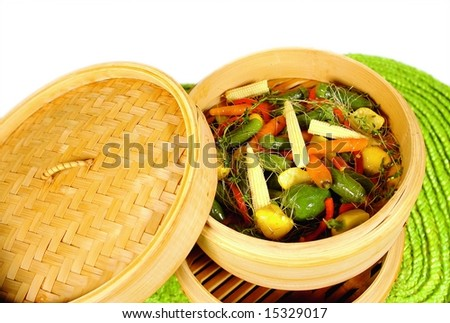 Bamboo steam cooker with vegetables - stock photo