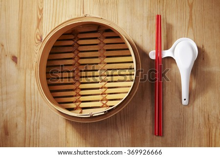 bamboo steamer with chopstick set - stock photo