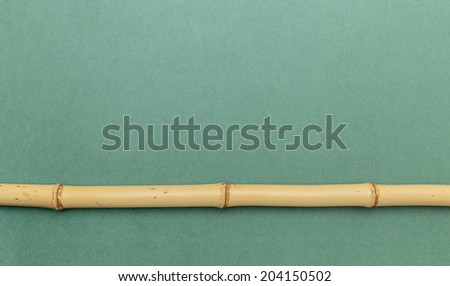 bamboo stick on a green background