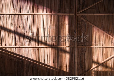 bamboo wall and locked door