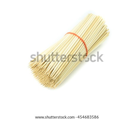 Bamboo wooden skewers  on white background - stock photo