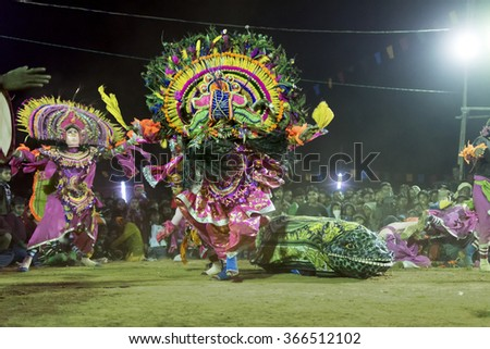 BAMNIA, PURULIA, WEST BENGAL , INDIA - DECEMBER 23RD 2015 : Dancers dressed as monster, performing at Chhau Dance festival. It is Indian tribal martial dance performed amongst spectators. - stock photo
