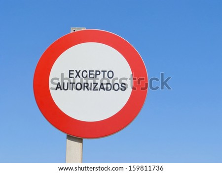 Ban on driving sign which says the spanish words Excepto Autorizados (=Except Authorized)