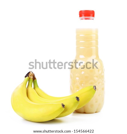 Banana and bottle of juice. On a white - stock photo