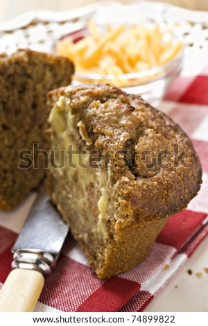 Banana and carrot bran muffins with cheese - stock photo