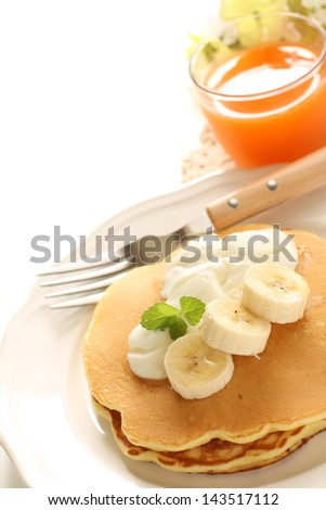 banana and yogurt on pancake with carrot juice for healthy breakfast image