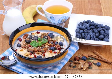 Banana & Blueberry Porridge with Nuts - stock photo