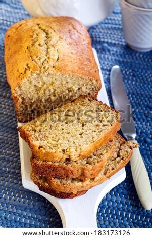 Banana bread, sliced on board - stock photo