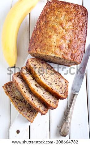 Banana cake on board, sliced - stock photo