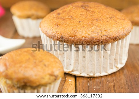 Banana cake rests on a wooden table. - stock photo