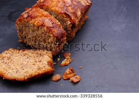 banana cake slice on black wooden - stock photo