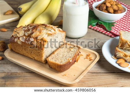Banana cake topping with almond slice.