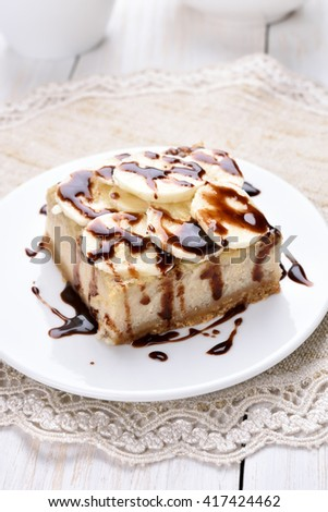 Banana cheese cake, covered with chocolate sauce and slices