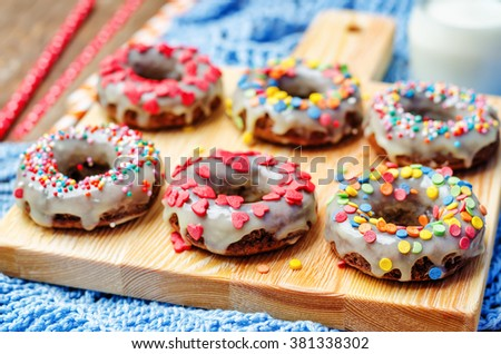 banana Donuts with icing and colorful sprinkles. toning. selective focus - stock photo