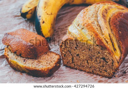Banana loaf multigrain bread biscuit cake, healthy snack on a grey table. Instagram filter. - stock photo